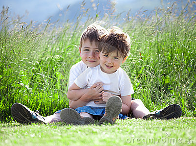 Siblings playing in field