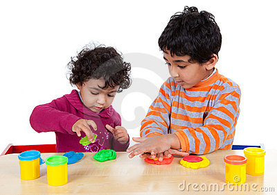 Siblings Playing with Play Dough
