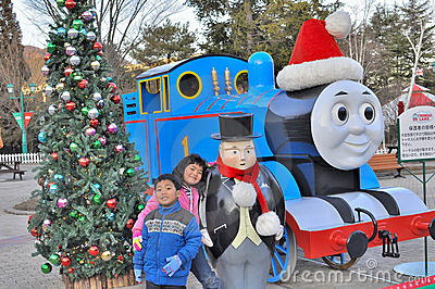 Siblings posing with thomas the train Editorial Photography