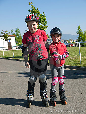 Siblings on rollerskates