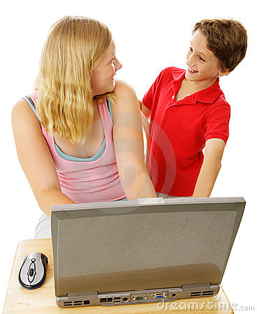 Siblings Using Computer