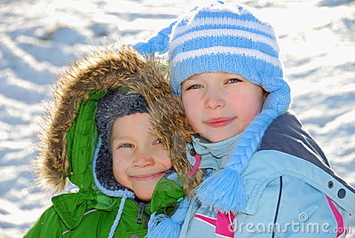 Siblings in winter clothes