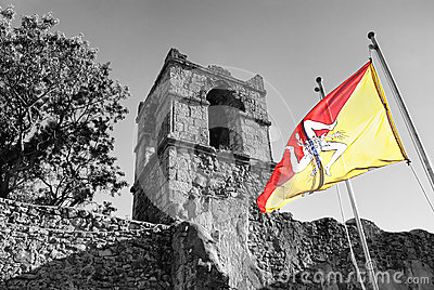 Sicilian flag on old architecture