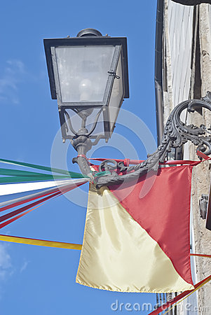 Sicilian flag and street lamp