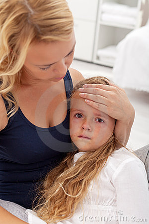 Sick child comforted by mother