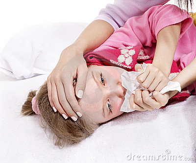 Sick child with handkerchief in bed.