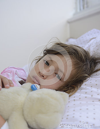 Sick child resting in bed