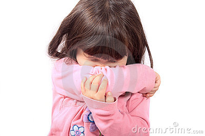 Sick child sneezing