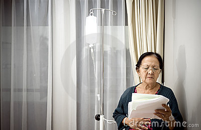 Sick elderly patient in hospital ward