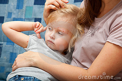 Sick girl in the arms of her mother