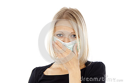 Sick girl in a medical mask
