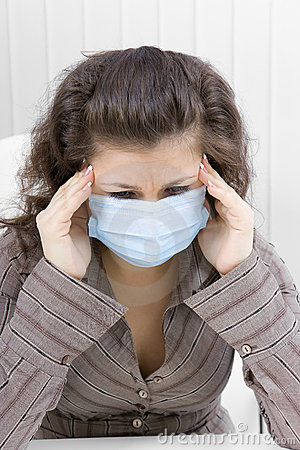The sick girl with medical mask with sad eyes