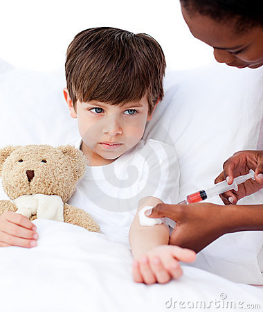 Sick little boy receiving an injection
