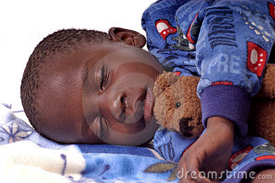Sick little boy sleeping with his teddy bear
