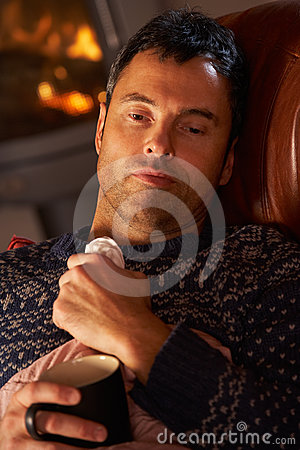 Sick Man With Cold Resting On Sofa