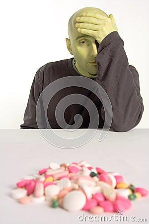 Free Sick Man Eyeing Medication Royalty Free Stock Images - 1702429