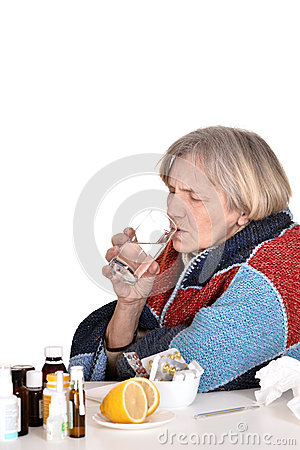 Free Sick Old Woman Drinks Water Stock Photography - 30815242