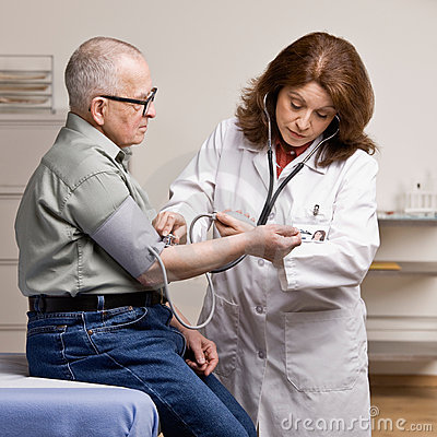 Sick patient having blood pressure taken