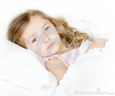 Sick or sad child in bed