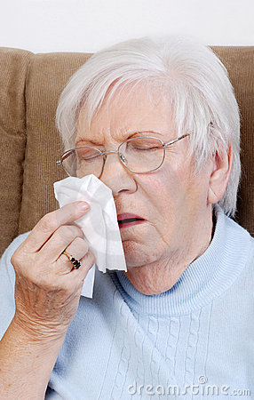 Sick senior sneezing