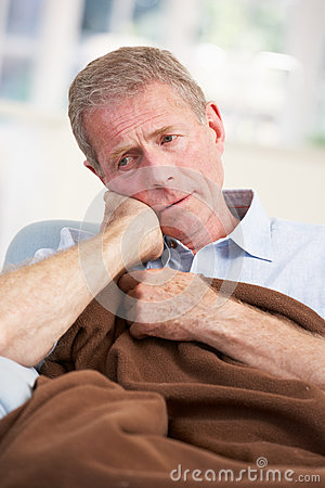 Sick, unhappy older man at home