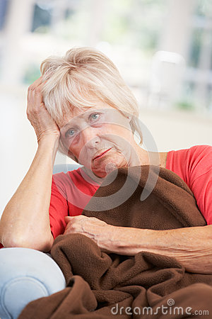 Sick, unhappy older woman at home