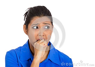 Sick woman biting her hand and looking to side anxious