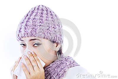 Sick woman blowing nose isolated in white