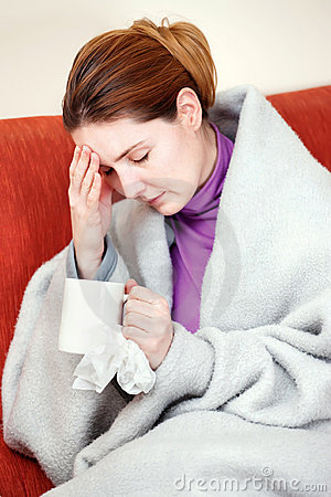 Sick woman with a cup of tea in her hand
