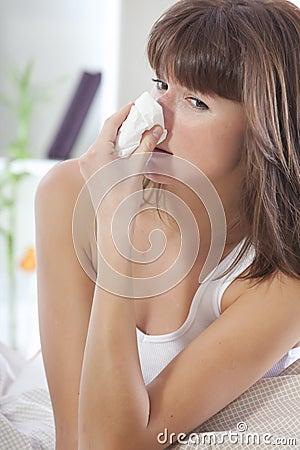 Sick woman sniffles
