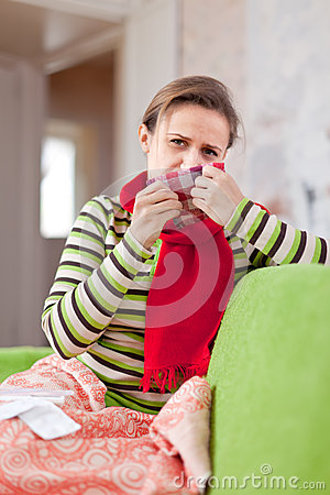 Sick woman uses handkerchief