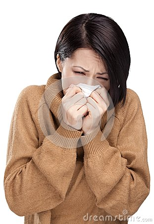 Sick young attractive woman holding wipe