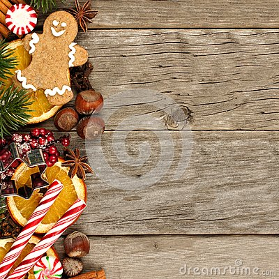 Free Side Border Of Christmas Decor And Treats Over Rustic Wood Stock Photography - 61876112