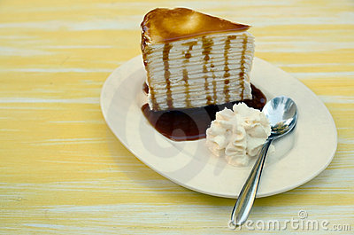 Side of Cream cake topped with caramel