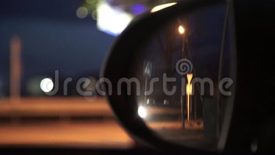 Side mirror rear view from standing car at night. stock video
