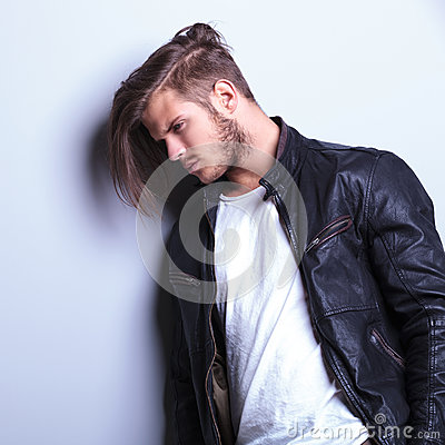 Free Side Of A Thoughtful Young Man In Leather Jacket Royalty Free Stock Photography - 34923497