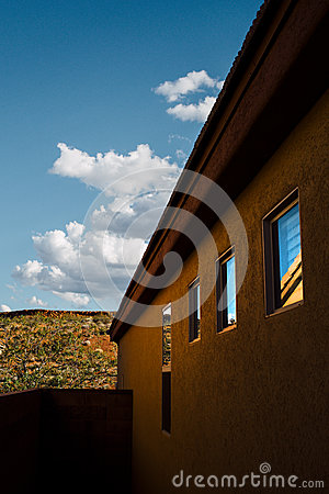 Free Side Of Adobe Home In Desert Landscape Stock Images - 91353534