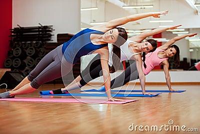 side plank yoga posethree women royalty free stock
