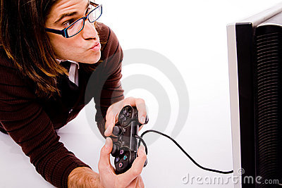 Side pose of man playing videogame