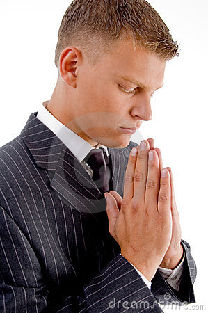Side pose of praying businessman