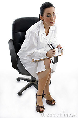 Side pose of sitting doctor with writing pad