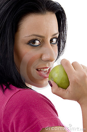 Side pose of smiling female eating apple