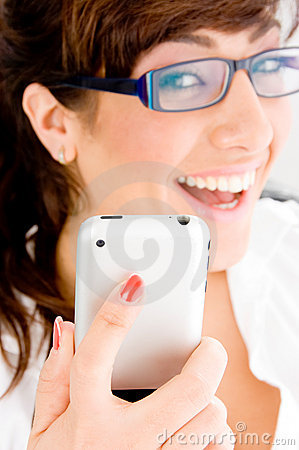 Side pose of smiling female holding ipod