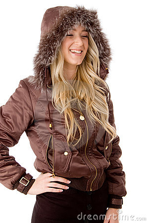 Side pose of smiling female wearing hood coat