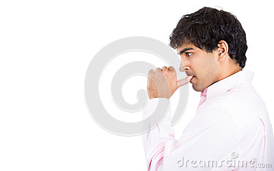 Side profile portrait of man with finger in mouth sucking thumb or biting fingernail in anxiety and stress