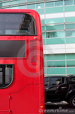 Side of Red London Double Decker Bus and Black Car