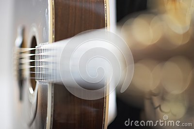 Side view of an acoustic western guitar