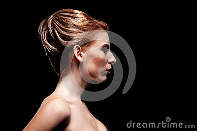 Side-view of alluring model with hairstyle