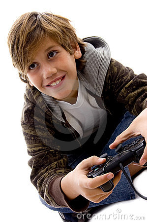Side view of amused boy playing videogame
