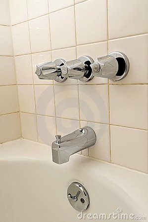 Side view of bathtub and water taps